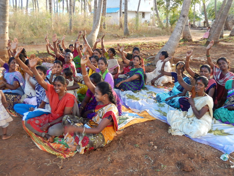 Women mill workers plan ways to prevent child and bonded labour. Photo: G Baumann