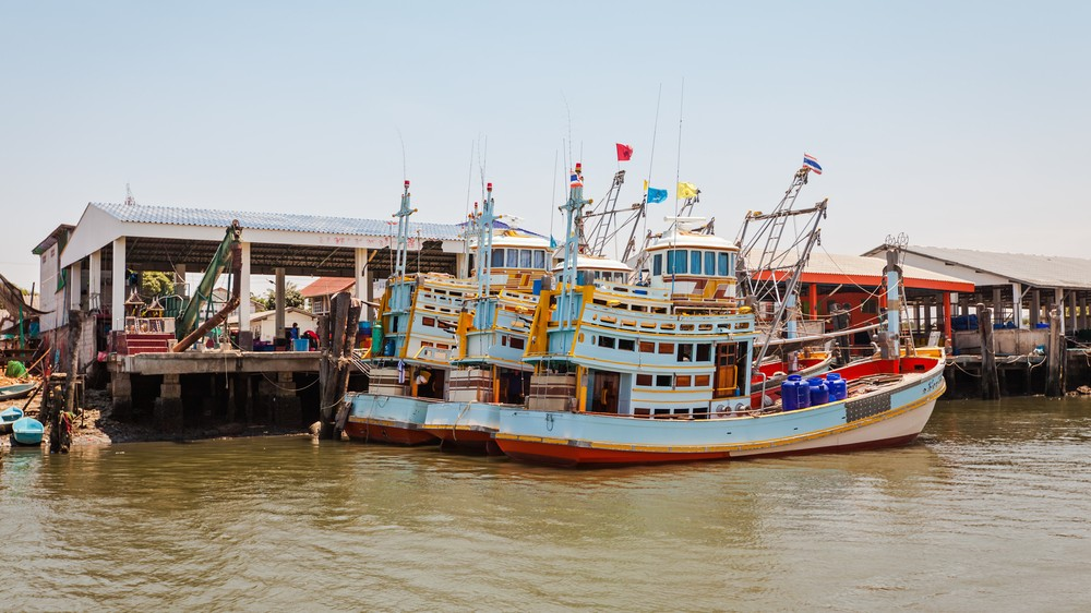 modern slavery supply chain Fishing boats in Thailand. SMIRNOVA IRINA / Shutterstock.com